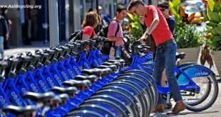 With AFP Story by Brigitte DUSSEAU: US-Transport-Bicycle-Share-CitiBike A couple get their Citi Bike bicycles from a station near Union Square as the bike sharing system is launched May 27, 2013 in New York. About 330 stations in Manhattan and Brooklyn will have thousands of bicycles for rent. AFP PHOTO/Stan HONDA        (Photo credit should read STAN HONDA/AFP/Getty Images)